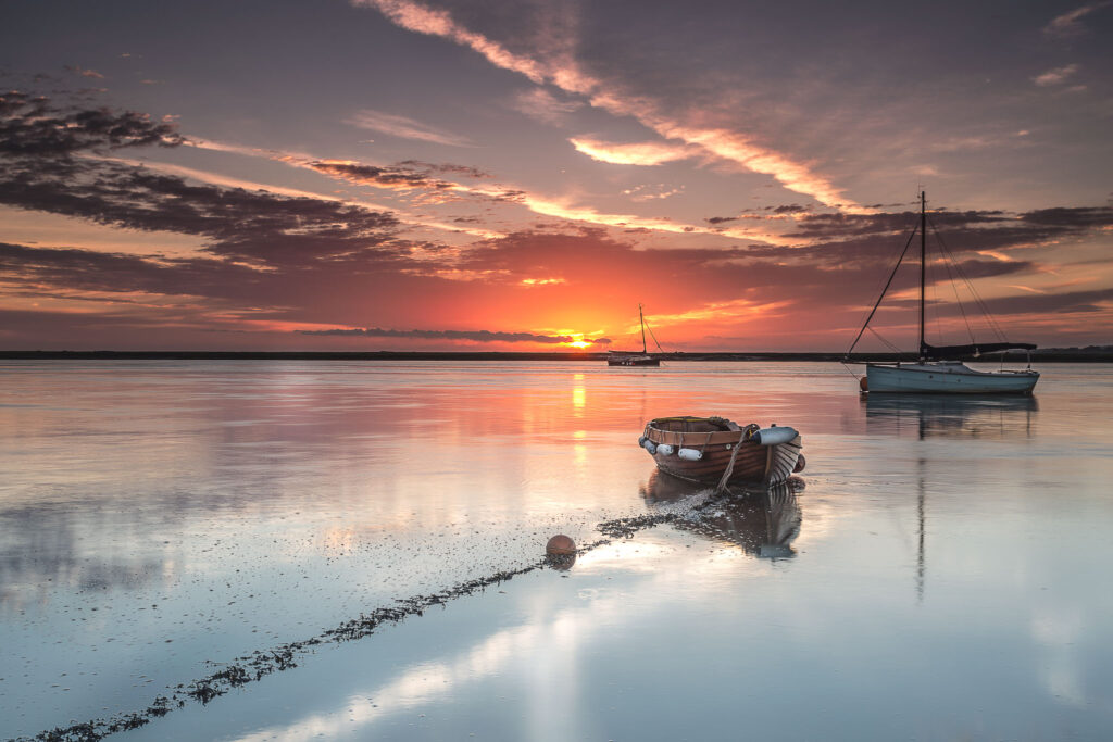 Norfolk boats Landscape photography workshop wells next sea boat at sunrise with reflections on the water