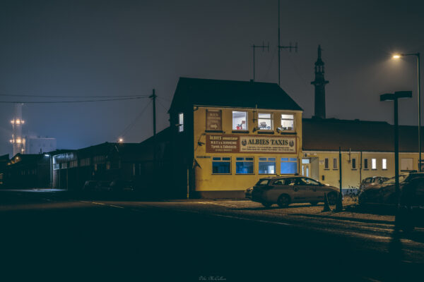 yarmouth at night taxi rank with the power station in the background in the fog